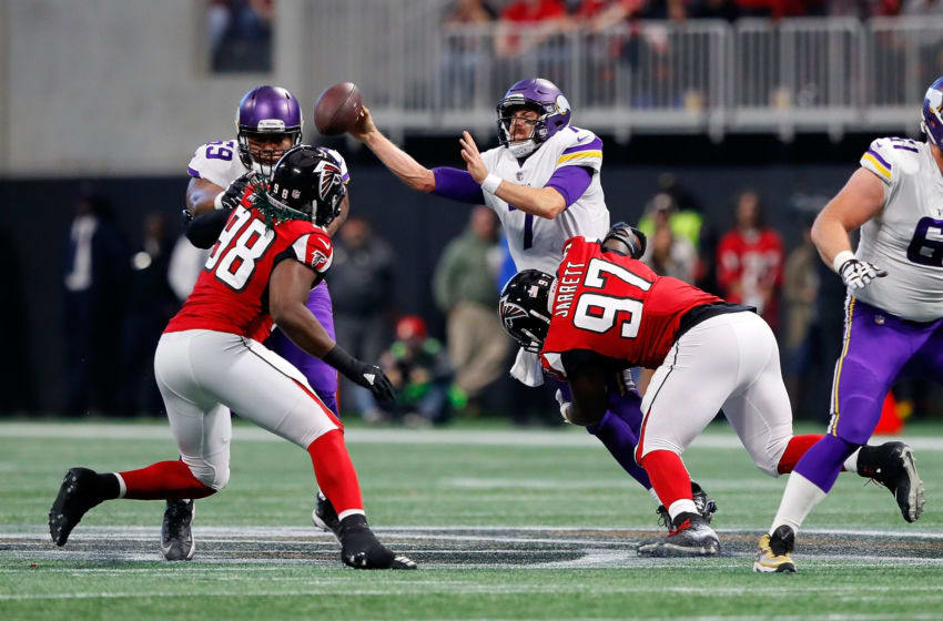 ATLANTA, GA - DECEMBER 03: Case Keenum #7 of the Minnesota Vikings is sacked by Grady Jarrett #97 of the Atlanta Falcons during the first half at Mercedes-Benz Stadium on December 3, 2017 in Atlanta, Georgia. (Photo by Kevin C. Cox/Getty Images)