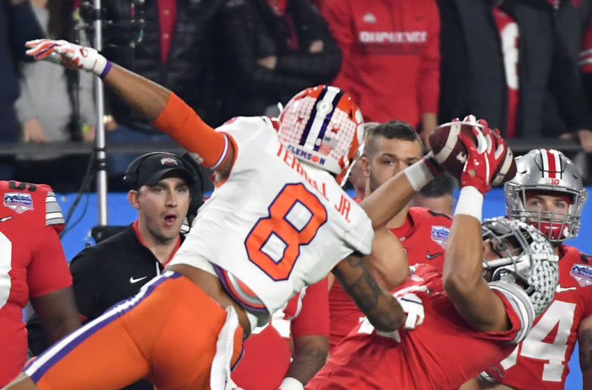 GLENDALE, ARIZONA - DECEMBER 28: Austin Mack #11 of the Ohio State Buckeyes makes a catch under pressure from A.J. Terrell #8 of the Clemson Tigers in the first half during the College Football Playoff Semifinal at the PlayStation Fiesta Bowl at State Farm Stadium on December 28, 2019 in Glendale, Arizona. (Photo by Norm Hall/Getty Images)