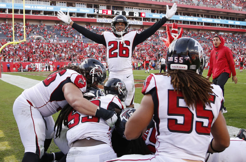 TAMPA, FLORIDA - DECEMBER 29: The Atlanta Falcons celebrate after Deion Jones #45 intercepted a pass by Jameis Winston #3 (not pictured) for a touchdown to defeat the Tampa Bay Buccaneers 28-22 in overtime at Raymond James Stadium on December 29, 2019 in Tampa, Florida. (Photo by Michael Reaves/Getty Images)