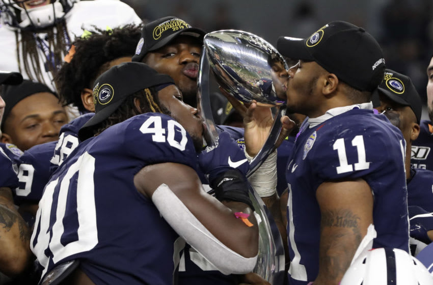 Dec 28, 2019; Arlington, Texas, USA; Penn State Nittany Lions linebacker Micah Parsons (11) and linebacker Jesse Luketa (40) kiss the Cotton Bowl trophy after the game against the Memphis Tigers at AT&T Stadium. Mandatory Credit: Kevin Jairaj-USA TODAY Sports