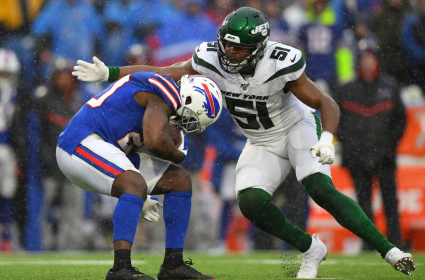 Dec 29, 2019; Orchard Park, New York, USA; Buffalo Bills running back Frank Gore (20) avoids the tackle attempt of New York Jets outside linebacker Brandon Copeland (51) during the second quarter at New Era Field. Mandatory Credit: Rich Barnes-USA TODAY Sports