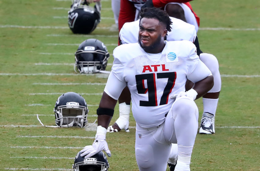 Aug 24, 2020; Flowery Branch, GA, USA; Atlanta Falcons defensive tackle Grady Jarrett loosens up for the second scrimmage on Monday, August 24, 2020 in Flowery Branch. Mandatory Credit: Curtis Compton/Pool Photo via USA TODAY Sports