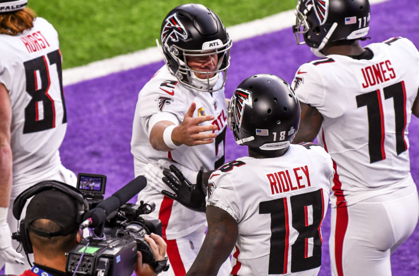 Oct 18, 2020; Minneapolis, Minnesota, USA; Atlanta Falcons quarterback Matt Ryan (2) and wide receiver Calvin Ridley (18) celebrate their 8-yard pass and catch for a touchdown in the second quarter against the Minnesota Vikings at U.S. Bank Stadium. Mandatory Credit: Nick Wosika-USA TODAY Sports