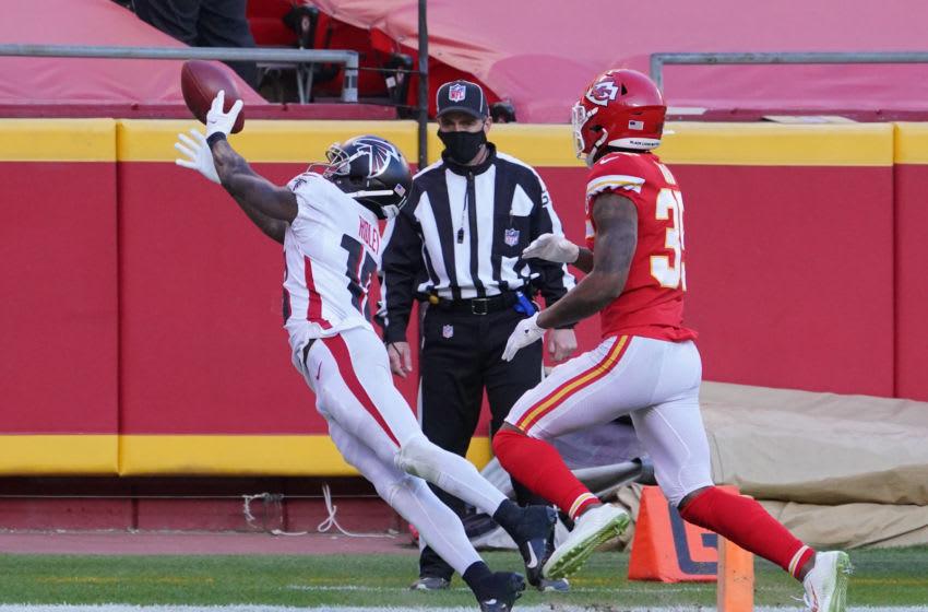 Dec 27, 2020; Kansas City, MO, USA; Atlanta Falcons wide receiver Calvin Ridley (18) cannot catch a pass as Kansas City Chiefs cornerback Charvarius Ward (35) defends at Arrowhead Stadium. Mandatory Credit: Denny Medley-USA TODAY Sports