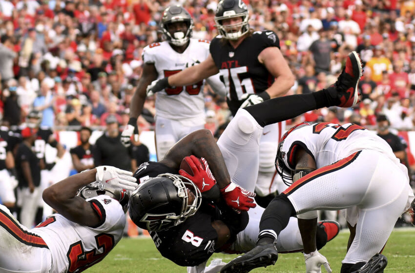 Sep 19, 2021; Tampa, Florida, USA; Atlanta Falcons tight end Kyle Pitts (8) gets tackled by Tampa Bay Buccaneers defensive back Jamel Dean (35) and defensive back Jordan Whitehead (33) in the second half at Raymond James Stadium. Mandatory Credit: Jonathan Dyer-USA TODAY Sports