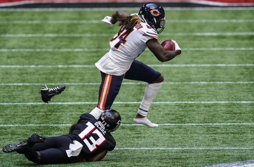 Sep 27, 2020; Atlanta, Georgia, USA; Chicago Bears wide receiver Cordarrelle Patterson (84) loses his shoe running against Atlanta Falcons wide receiver Christian Blake (13) on a punt return during the third quarter at Mercedes-Benz Stadium. Mandatory Credit: Dale Zanine-USA TODAY Sports