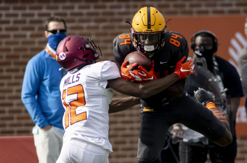 Jan 30, 2021; Mobile, AL, USA; National wide receiver Frank Darby of Arizona State (84) grabs a pass as American defensive back Bryan Mills of North Carolina Central (12) defends in the first half of the 2021 Senior Bowl at Hancock Whitney Stadium. Mandatory Credit: Vasha Hunt-USA TODAY Sports