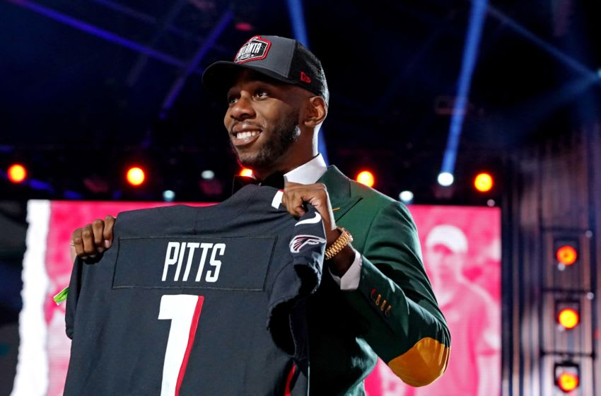 Apr 29, 2021; Cleveland, Ohio, USA; Kyle Pitts (Florida) poses with a jersey after being selected by Atlanta Falcons as the number four overall pick in the first round of the 2021 NFL Draft at First Energy Stadium. Mandatory Credit: Kirby Lee-USA TODAY Sports
