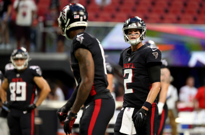Aug 29, 2021; Atlanta Falcons quarterback Matt Ryan (2) talks with tight end Kyle Pitts (8) before their game against the Cleveland Browns at Mercedes-Benz Stadium. Mandatory Credit: Jason Getz-USA TODAY Sports
