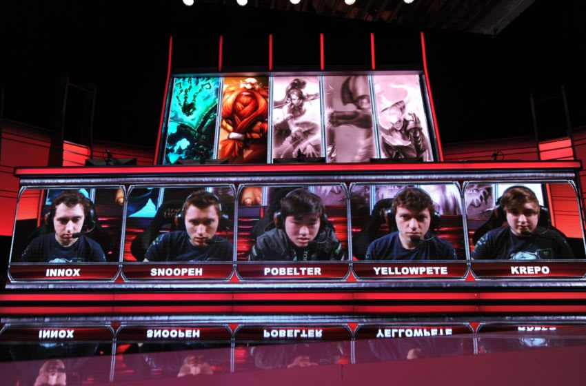 Team members including 'Krepo' of the 'Evil Genius' team are seen on the screen during the live taping of the League of Legends North American Championship Series Spring round robin competition, at the MBS Media Campus in Manhattan Beach, California February 22, 2014. League of Legends, one of the world's most popular multiplayer online battle arena video game, has a fully professional competitive league and a top prize of one million dollars. AFP PHOTO / ROBYN BECK (Photo credit should read ROBYN BECK/AFP/Getty Images)