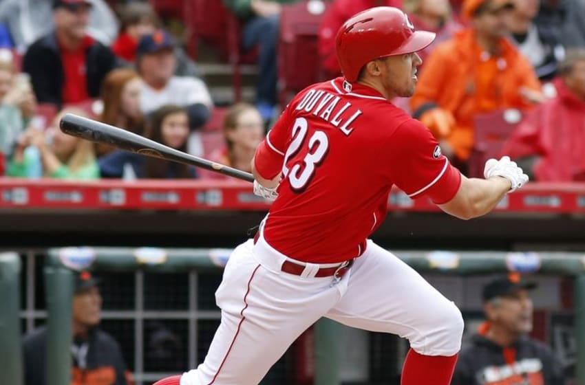 May 4, 2016; Cincinnati, OH, USA; Cincinnati Reds left fielder Adam Duvall hits a solo home run during the sixth inning against the San Francisco Giants at Great American Ball Park. Mandatory Credit: David Kohl-USA TODAY Sports