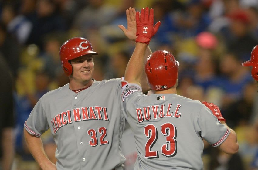 May 24, 2016; Los Angeles, CA, USA; Cincinnati Reds left fielder Adam Duvall (23) is greeted by right fielder Jay Bruce (32) after a home run in the fourth inning of the game against the Los Angeles Dodgers at Dodger Stadium. Mandatory Credit: Jayne Kamin-Oncea-USA TODAY Sports