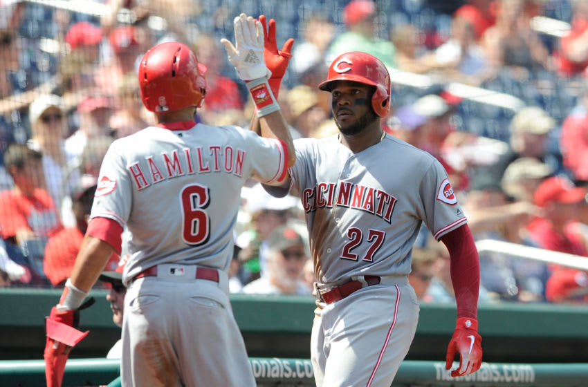WASHINGTON, DC - AUGUST 04: Phillip Ervin #27 of the Cincinnati Reds celebrates with Billy Hamilton #6 after driving him in with a sacrifice fly in the sixth inning against the Washington Nationals during game one of a doubleheader at Nationals Park on August 4, 2018 in Washington, DC. (Photo by Greg Fiume/Getty Images)