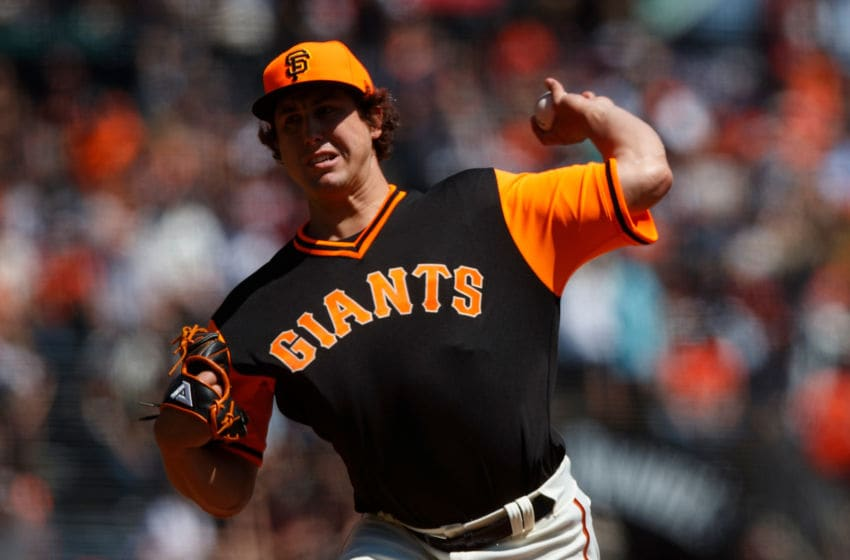 SAN FRANCISCO, CA - AUGUST 26: Derek Holland #45 of the San Francisco Giants pitches against the Texas Rangers during the first inning at AT&T Park on August 26, 2018 in San Francisco, California. All players across MLB will wear nicknames on their backs as well as colorful, non traditional uniforms featuring alternate designs inspired by youth-league uniforms during Players Weekend. (Photo by Jason O. Watson/Getty Images)