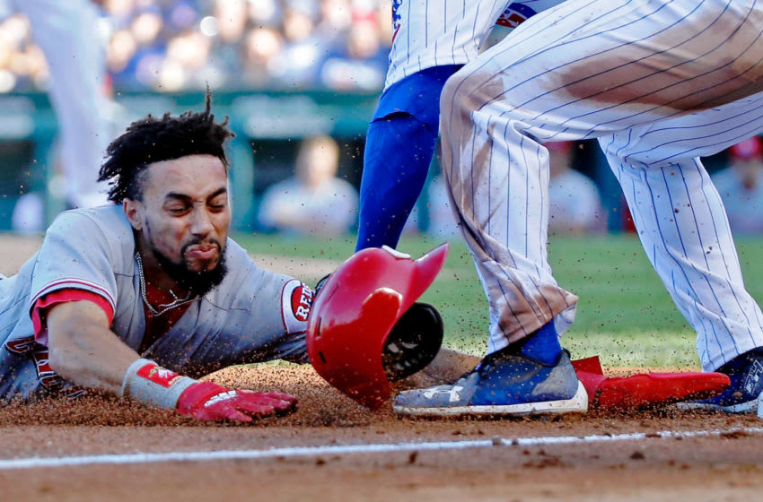 CHICAGO, IL - SEPTEMBER 15: David Bote #13 of the Chicago Cubs tags out Billy Hamilton #6 of the Cincinnati Reds as he attempts to steal third base during the sixth inning at Wrigley Field on September 15, 2018 in Chicago, Illinois. (Photo by Jon Durr/Getty Images)