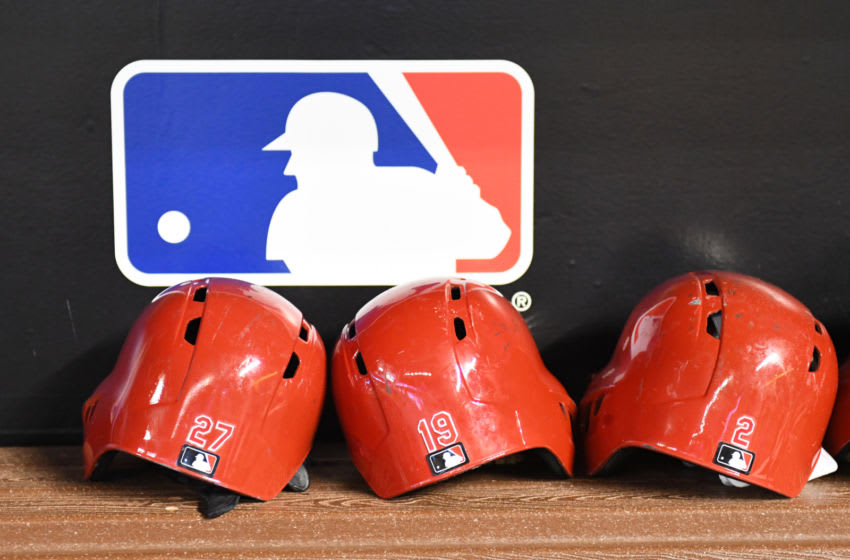 MIAMI, FL - SEPTEMBER 21: A detailed view of the batting helmets of Phillip Ervin #27 and Joey Votto #19 of the Cincinnati Reds in the dugout before the start of the game against the Miami Marlins at Marlins Park on September 21, 2018 in Miami, Florida. (Photo by Eric Espada/Getty Images)