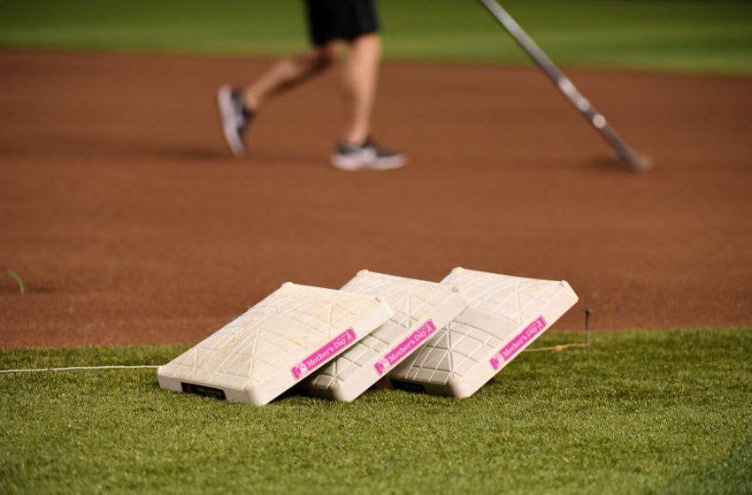 PHOENIX, ARIZONA - MAY 12: The bases for the Arizona Diamondbacks and the Atlanta Braves game have pink badges on the side of them in celebration of Mother's Day at Chase Field on May 12, 2019 in Phoenix, Arizona. (Photo by Norm Hall/Getty Images)