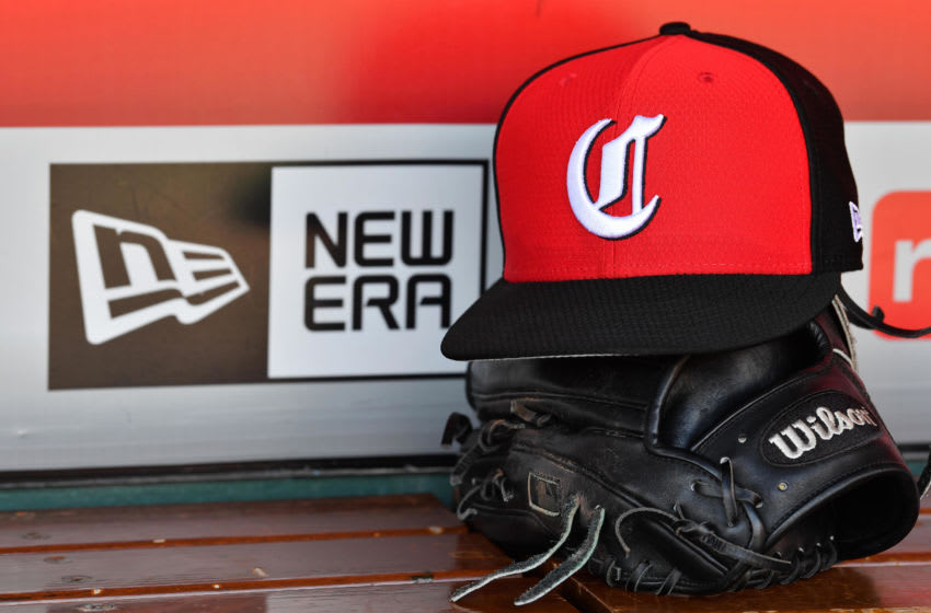 CINCINNATI, OH - MAY 14: A close up view of a hat and baseball glove in the dugout with the New Era logo before a game between the Cincinnati Reds and the Chicago Cubs. (Photo by Jamie Sabau/Getty Images) *** Local Caption ***