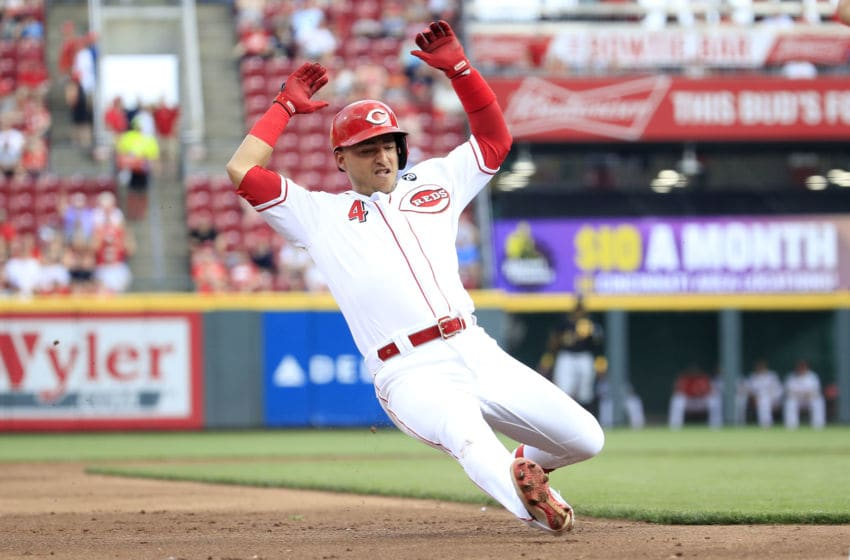 CINCINNATI, OHIO - MAY 28: Jose Iglesias #4 of the Cincinnati Reds slides into third base for a triple against the Pittsburgh Pirates at Great American Ball Park on May 28, 2019 in Cincinnati, Ohio. (Photo by Andy Lyons/Getty Images)