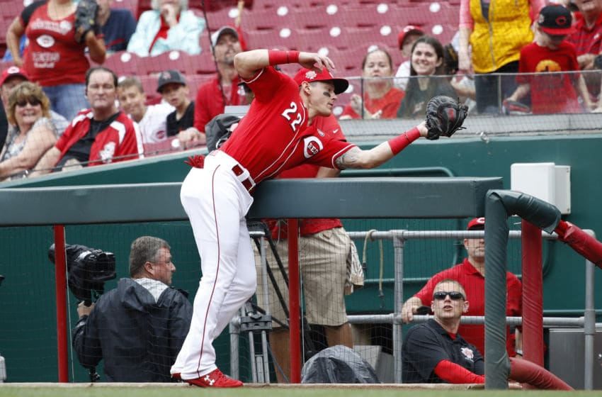 CINCINNATI, OH - MAY 29: Derek Dietrich #22 of the Cincinnati Reds catches a foul ball over the dugout railing in the first inning of a game against the Pittsburgh Pirates at Great American Ball Park on May 29, 2019 in Cincinnati, Ohio. (Photo by Joe Robbins/Getty Images)