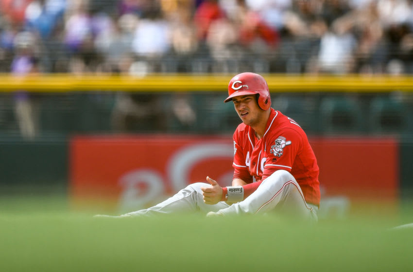 DENVER, CO - JULY 14: Jose Iglesias #4 of the Cincinnati Reds sits dejected after being picked off and tagged out attempting to steal second base to end the top of the eighth inning of a game against the Colorado Rockies at Coors Field on July 14, 2019 in Denver, Colorado. (Photo by Dustin Bradford/Getty Images)