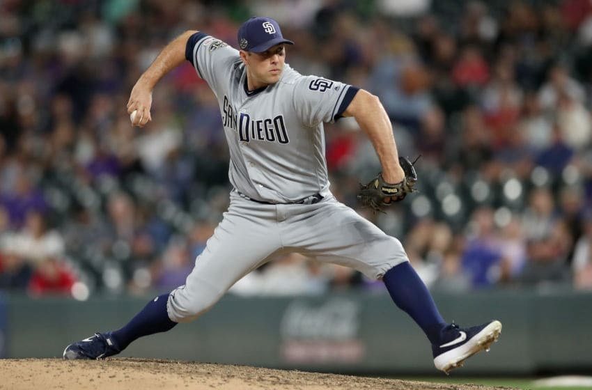 DENVER, COLORADO - JUNE 13: Pitcher Craig Stammen #34 of the San Diego Padres throws in the eighth inning against the Colorado Rockies at Coors Field on June 13, 2019 in Denver, Colorado. (Photo by Matthew Stockman/Getty Images)