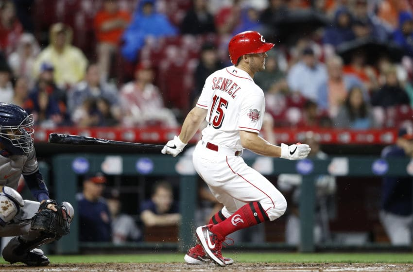 CINCINNATI, OH - JUNE 17: Nick Senzel #15 of the Cincinnati Reds hits a single to center field to drive in two runs in the fifith inning against the Houston Astros at Great American Ball Park on June 17, 2019 in Cincinnati, Ohio. The Reds won 3-2. (Photo by Joe Robbins/Getty Images)