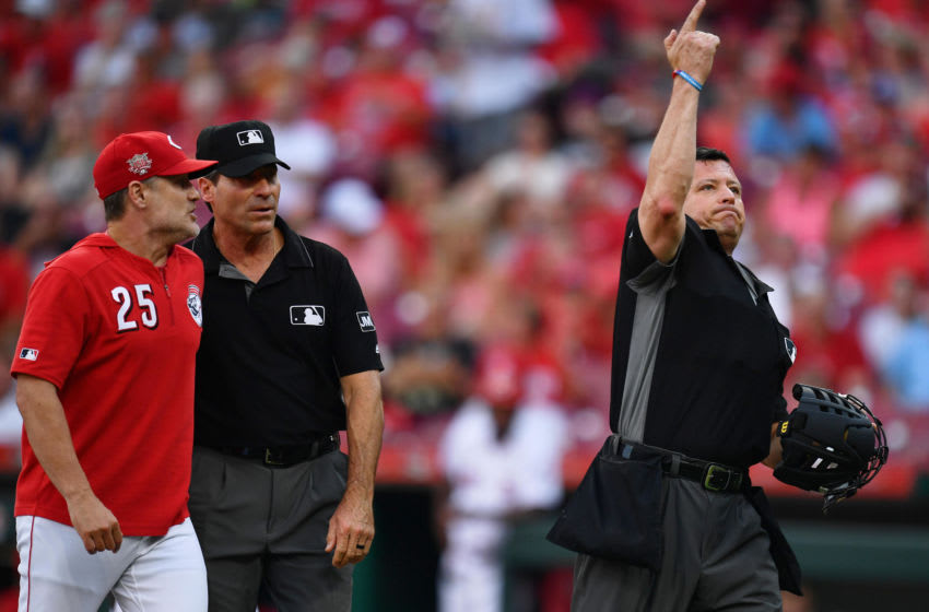 CINCINNATI, OH - JULY 19: Home plate umpire Carlos Torres #37 ejects Manager David Bell #25 of the Cincinnati Reds after Bell argued with Torres after the first inning. (Photo by Jamie Sabau/Getty Images)