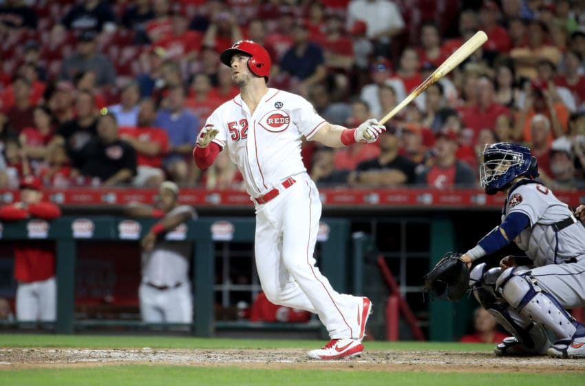 CINCINNATI, OHIO - JUNE 18: Kyle Farmer #52 of the Cincinnati Reds hits a home run in the 7th inning against the Houston Astros at Great American Ball Park on June 18, 2019 in Cincinnati, Ohio. (Photo by Andy Lyons/Getty Images)