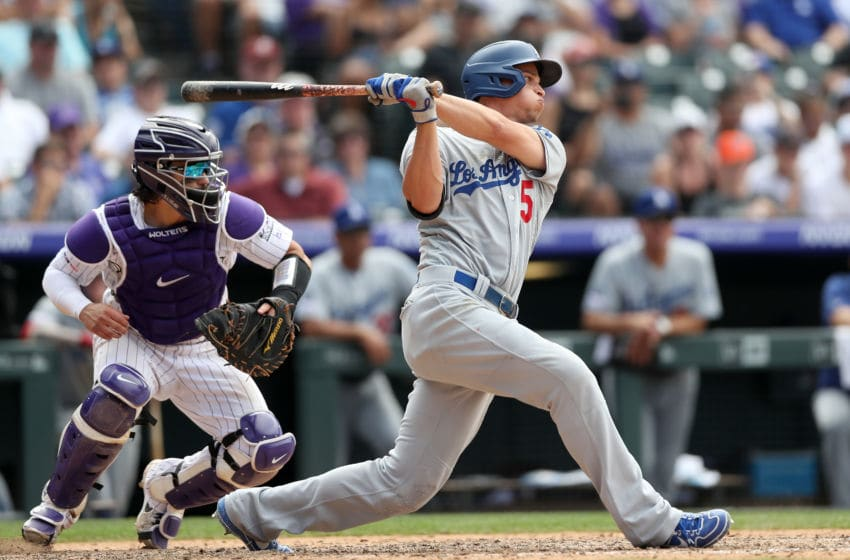DENVER, COLORADO - JULY 31: Corey Seager #5 of the Los Angeles Dodgers hits a single in the ninth inning against the Colorado Rockies at Coors Field on July 31, 2019 in Denver, Colorado. (Photo by Matthew Stockman/Getty Images)