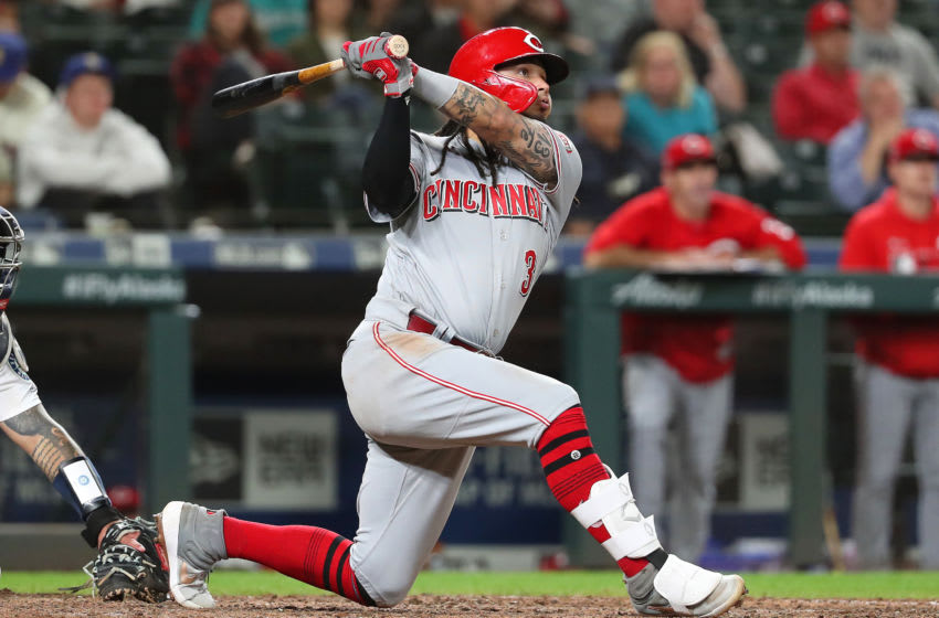 SEATTLE, WASHINGTON - SEPTEMBER 12: Freddy Galvis #3 of the Cincinnati Reds watches his grand slam in the seventh inning to give the Cincinnati Reds a 7-5 lead against the Seattle Mariners during their game at T-Mobile Park on September 12, 2019 in Seattle, Washington. (Photo by Abbie Parr/Getty Images)