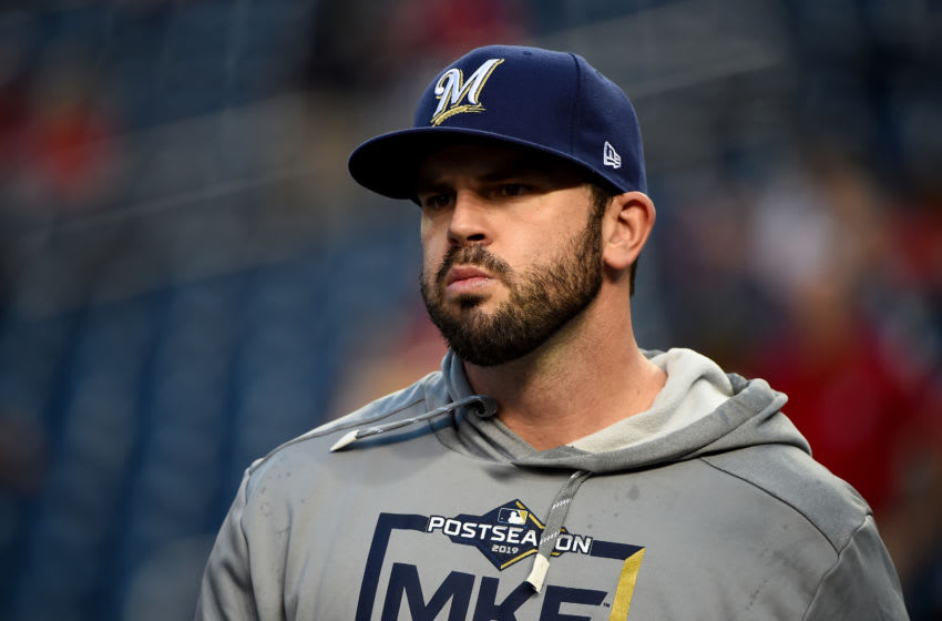 WASHINGTON, DC - OCTOBER 01: Mike Moustakas #11 of the Milwaukee Brewers looks on during batting practice prior to the National League Wild Card game against the Washington Nationals at Nationals Park on October 01, 2019 in Washington, DC. (Photo by Will Newton/Getty Images)