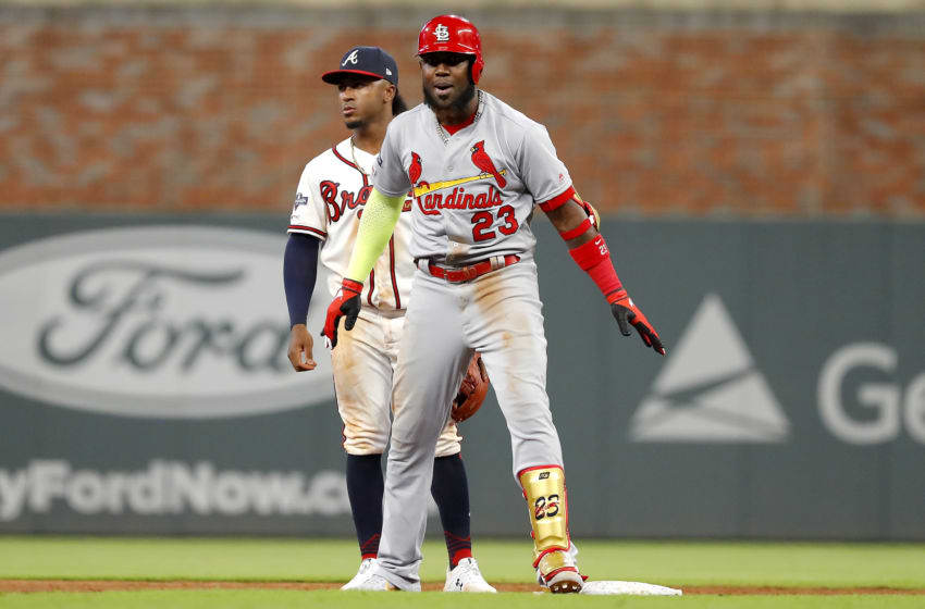 ATLANTA, GEORGIA - OCTOBER 03: Marcell Ozuna #23 of the St. Louis Cardinals celebrates after hitting a two-RBI double against the Atlanta Braves during the ninth inning in game one of the National League Division Series at SunTrust Park on October 03, 2019 in Atlanta, Georgia. (Photo by Kevin C. Cox/Getty Images)