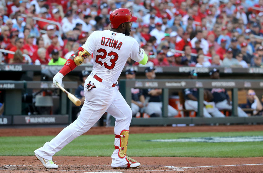 ST LOUIS, MISSOURI - OCTOBER 07: Marcell Ozuna #23 of the St. Louis Cardinals hits his second solo home run of the game, against the Atlanta Braves during the fourth inning in game four of the National League Division Series at Busch Stadium on October 07, 2019 in St Louis, Missouri. (Photo by Scott Kane/Getty Images)