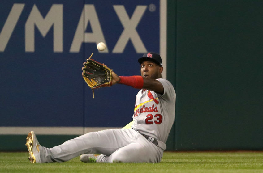 WASHINGTON, DC - OCTOBER 14: Marcell Ozuna #23 of the St. Louis Cardinals attempts to make the catch on an RBI double by Anthony Rendon #6 of the Washington Nationals in the third inning of game three of the National League Championship Series at Nationals Park on October 14, 2019 in Washington, DC. (Photo by Patrick Smith/Getty Images)