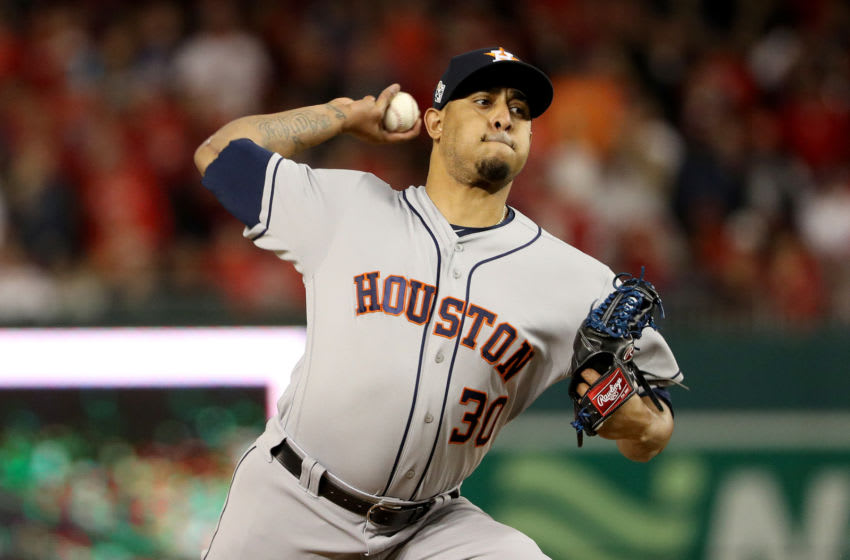 WASHINGTON, DC - OCTOBER 26: Hector Rondon #30 of the Houston Astros delivers the pitch against the Washington Nationals during the seventh inning in Game Four of the 2019 World Series at Nationals Park on October 26, 2019 in Washington, DC. (Photo by Patrick Smith/Getty Images)