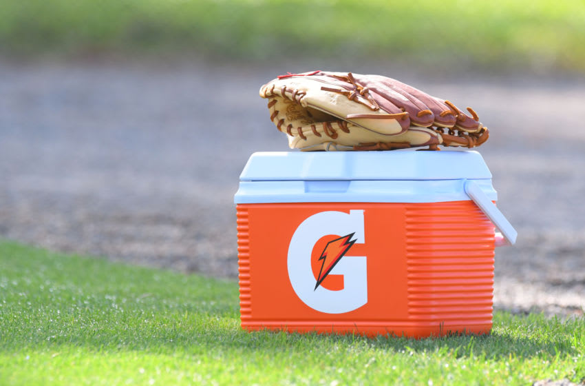 LAKELAND, FL - FEBRUARY 17: A detailed view of a Gatorade cooler and a baseball glove sitting on the field during the Detroit Tigers Spring Training workouts at the TigerTown Facility on February 17, 2020 in Lakeland, Florida. (Photo by Mark Cunningham/MLB Photos via Getty Images)