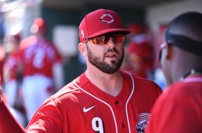 GOODYEAR, ARIZONA - FEBRUARY 24: Mike Moustakas #9 of the Cincinnati Reds (Photo by Norm Hall/Getty Images)