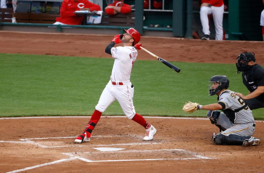 CINCINNATI, OH - APRIL 06: Tyler Naquin #12 of the Cincinnati Reds hits a three-run home run. (Photo by Kirk Irwin/Getty Images)