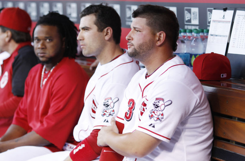 CINCINNATI, OH - AUGUST 29: Yonder Alonso #23 of the Cincinnati Reds sits alongside teammate Joey Votto #19 as he looks on during the game. (Photo by Joe Robbins/Getty Images)