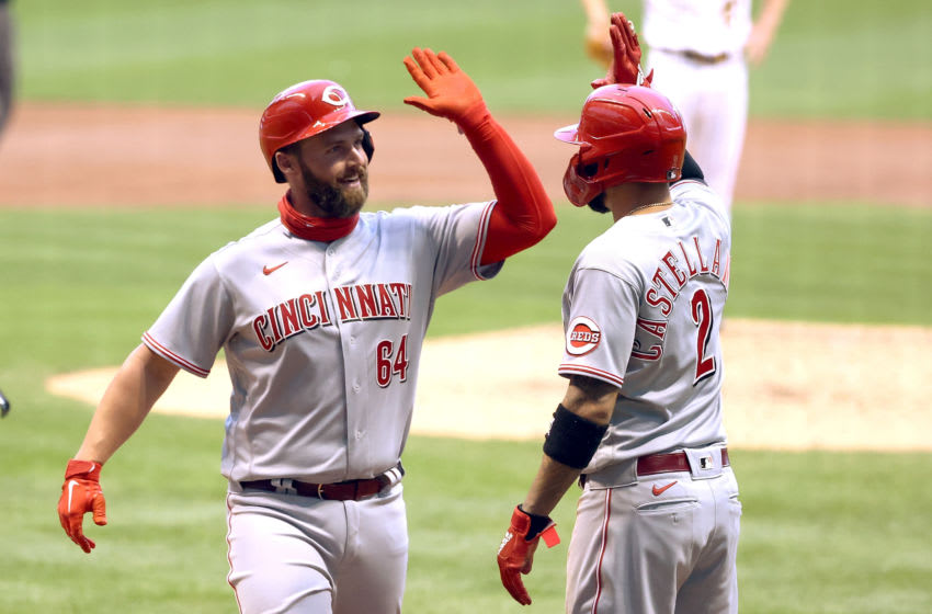 MILWAUKEE, WISCONSIN - AUGUST 07: Matt Davidson #64 and Nick Castellanos #2 of the Cincinnati Reds (Photo by Dylan Buell/Getty Images)