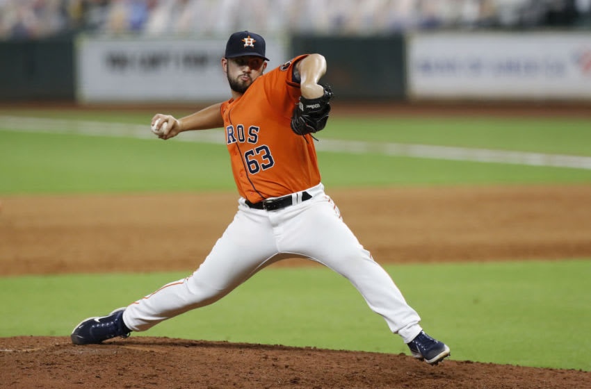 HOUSTON, TEXAS - AUGUST 14: Brandon Bailey #63 of the Houston Astros pitches in the eighth inning. (Photo by Tim Warner/Getty Images)