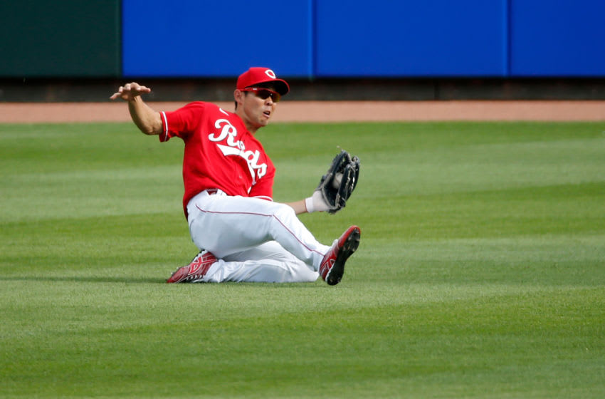 CINCINNATI, OH - AUGUST 29: Shogo Akiyama #4 of the Cincinnati Reds makes a sliding catch. (Photo by Kirk Irwin/Getty Images)