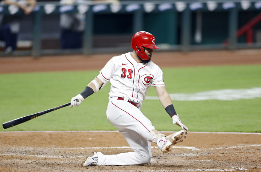 CINCINNATI, OH - SEPTEMBER 02: Jesse Winker #33 of the Cincinnati Reds falls after swinging and missing a pitch. (Photo by Joe Robbins/Getty Images)