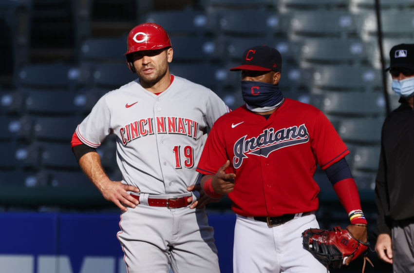 CLEVELAND, OH - AUGUST 06: Joey Votto #19 of the Cincinnati Reds stands with Carlos Santana #41 of the Cleveland Indians during the first inning. (Photo by Ron Schwane/Getty Images)
