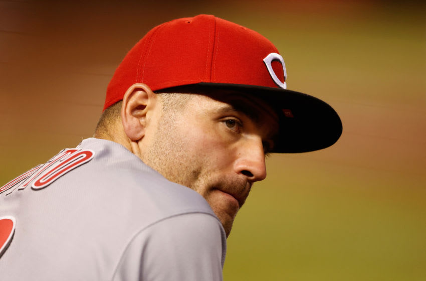 PHOENIX, ARIZONA - APRIL 09: Joey Votto #19 of the Cincinnati Reds watches from the dugout. (Photo by Christian Petersen/Getty Images)