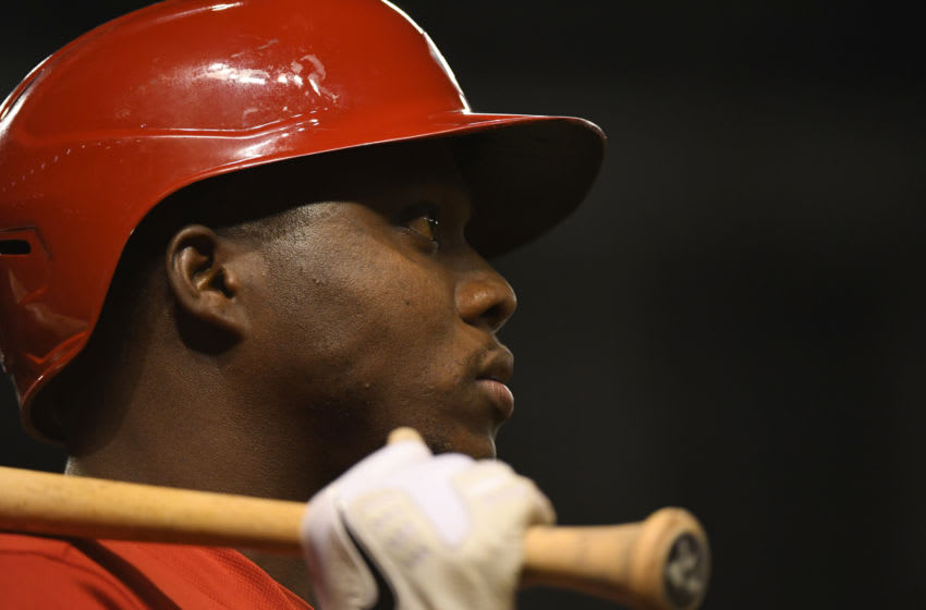 PHOENIX, ARIZONA - APRIL 10: Aristides Aquino #44 of the Cincinnati Reds gets ready in the on deck circle. (Photo by Norm Hall/Getty Images)