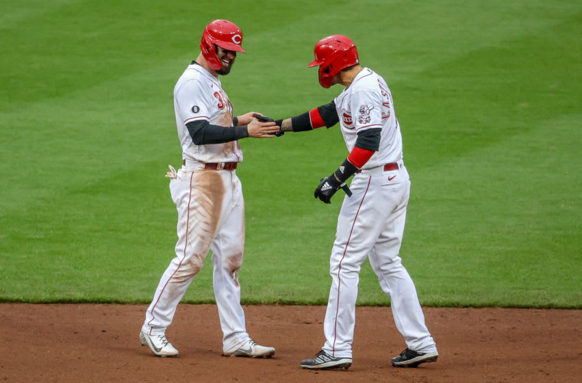 CINCINNATI, OHIO - APRIL 17: Jesse Winker #33 and Nick Castellanos #2 of the Cincinnati Reds celebrate in the ninth inning. (Photo by Dylan Buell/Getty Images)