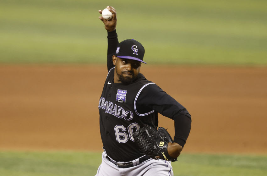 MIAMI, FLORIDA - JUNE 09: Mychal Givens #60 of the Colorado Rockies delivers a pitch. (Photo by Michael Reaves/Getty Images)