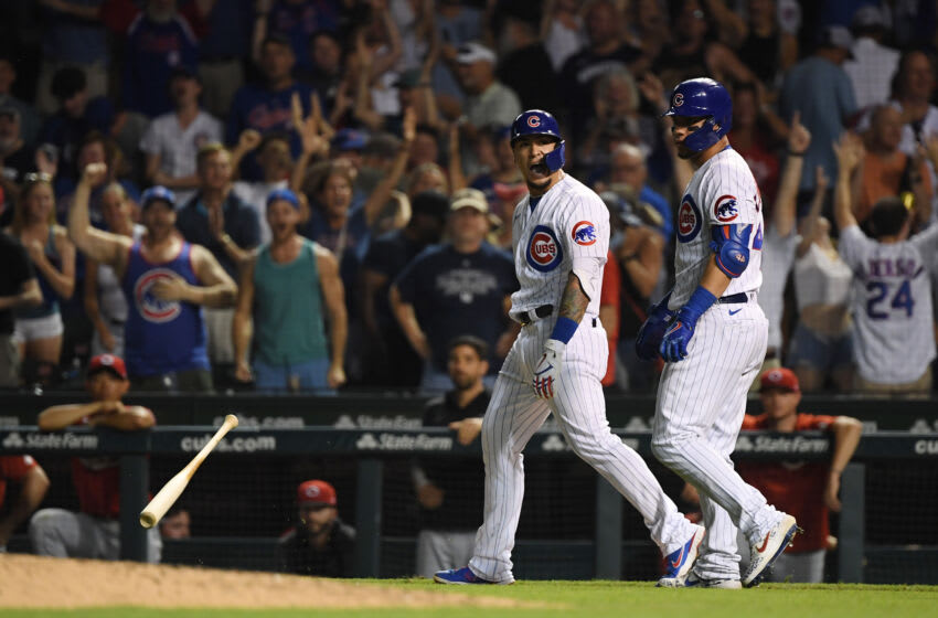 CHICAGO, ILLINOIS - JULY 26: Javier Baez #9 of the Chicago Cubs reacts after his walk off single in the ninth inning against the Cincinnati Reds. (Photo by Quinn Harris/Getty Images)
